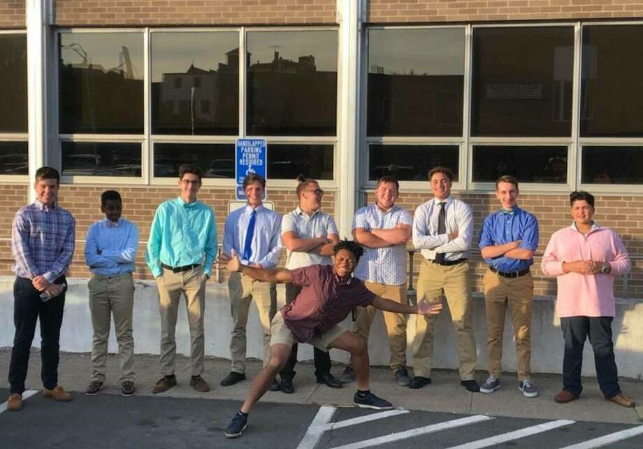 Middletown High lacrosse players past and present pose outside City Hall after the Board of Education gave a green light for varsity funding. From left: Kyle Dale, Marshall Alleyne, Aaron Mierz, Luke Reynolds, Matteo Parent, graduate Thomas Hummel, Eric Byrd, Ethan Foligno, incoming freshman Alex Cruz and Kristian Glemaud (front). Photo: Submitted