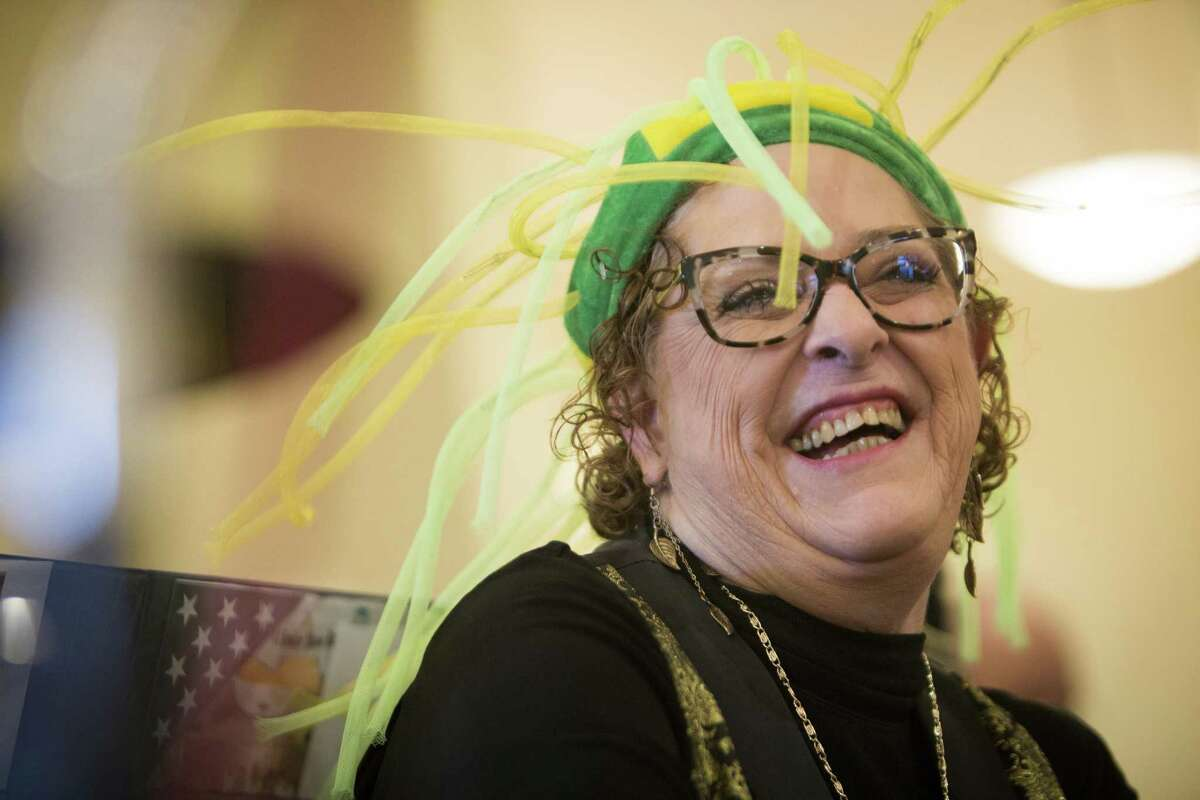 Diane Mosier, 67, wears a funny hat and enjoys the moment during a performance by the Sunshiners Band which she has been a member of for six years. Friday, Feb. 26, 2016. Mosier has been performing with the band for the past six years. ( Marie D. De Jesus / Houston Chronicle )