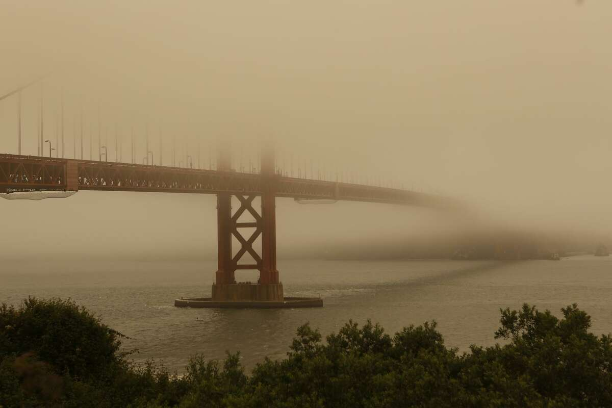 The Golden Gate Bridge was nearly hidden in fog and smoke from the Yolo County fires earlier this year.