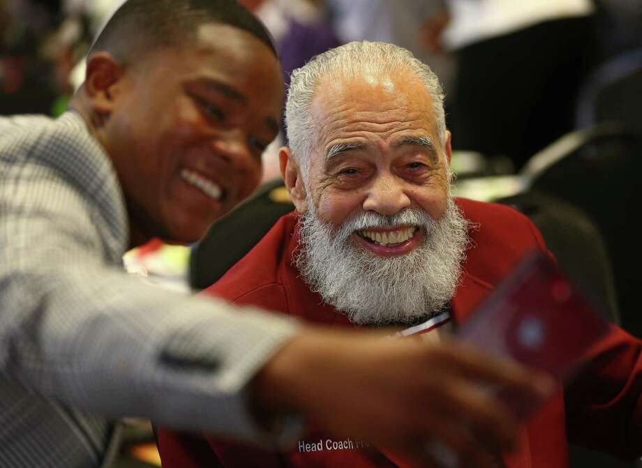 The stern but encouraging founder and longtime coach of Texas Southern University's debate team, Thomas F. Freeman, center, poses for a selfie with Adonis Warren, a current student, while celebrating his 99th birthday at the university Saturday. Photo: Godofredo A. Vasquez, Houston Chronicle / Houston Chronicle / Godofredo A. Vasquez