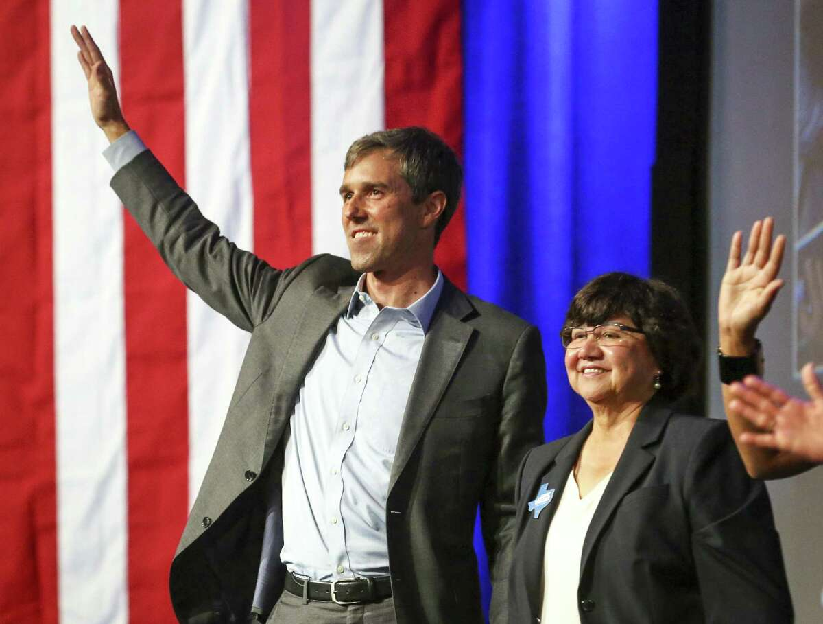 U.S. Senate candidate Beto O'Rourke and gubernatorial candidate Lupe Valdez salute the crowd at the general session at the Texas Democratic Convention on June 22 in Fort Worth.
