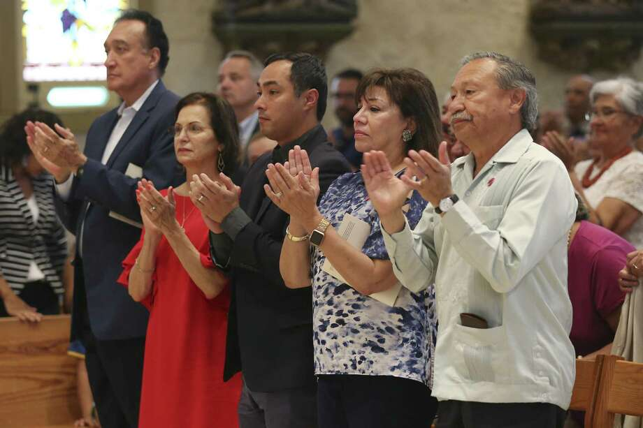 From left, former Secretary of Housing and Urban Development under President Bill Clinton, Henry Cisneros, his wife and former San Antonio City Council member Mary Alice Cisneros, U.S. Congressman Joaquin Castro, Sonia Rodriguez and her husband, United Farm Workers of American President Arturo Rodriguez, attend a Mass in honor of American labor leader and civil rights activist Cesar Chavez, at San Fernando Cathedral, Sunday, July 1, 2018. San Antonio Archbishop Gustavo Garcia-Siller offered a prayer for migrants and refugees was offered at the end of the service. Photo: JERRY LARA / San Antonio Express-News / San Antonio Express-News