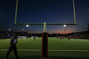 The sun sets as Caney Creek and New Caney take a timeout during the varsity football game on Friday, Sept. 22, 2017, at Moorhead Stadium. (Michael Minasi / Chronicle)