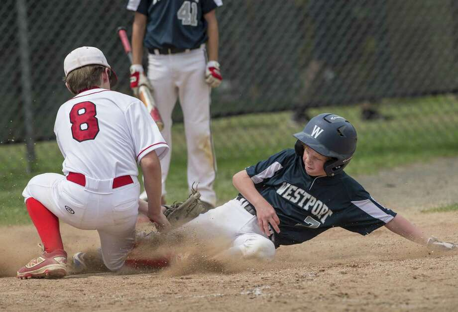 Westport's Dylan Hill slides safely into home as Fairfield American's Pierce Cowles can't get the tag down in time during a district 2 11-12 year olds little league game played at Unity Park, Trumbull, CT. Sunday, July 1, 2018. Photo: Mark Conrad / For Hearst Connecticut Media / © 2018 Mark F Conrad