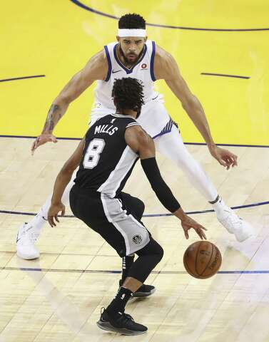 1afb056931 Golden State Warriors  JaVale McGee guards San Antonio Spurs  Patty Mills  in the first