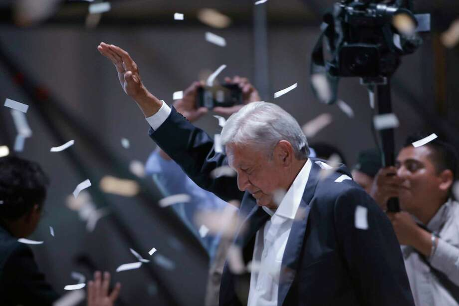 Presidential candidate Andres Manuel Lopez Obrador waves to supporters as he arrives to Mexico City's main square, the Zocalo, Sunday, July 1, 2018. Lopez Obrador has claimed victory in Mexico's presidential election, calling for reconciliation. Photo: Moises Castillo, AP / Copyright 2018 The Associated Press. All rights reserved