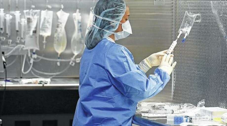 A pharmacy technician prepares syringes containing fentanyl in the sterile-medicines area of the inpatient pharmacy at the University of Utah Hospital in Salt Lake City. Amid the nation's opioid epidemic, hospitals are struggling to get widely used injected pain medicines because of ongoing supply shortages. Photo:       Rick Bowmer | Associated Press