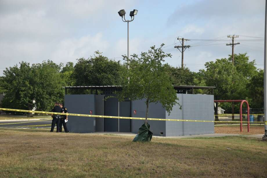 San Antonio police investigate a crime scene at Fernando Herrera Park near Roland Road and Interstate 10 after a body was found in a bathroom on Monday, July 2, 2018. Photo: Caleb Downs/San Antonio Express-News