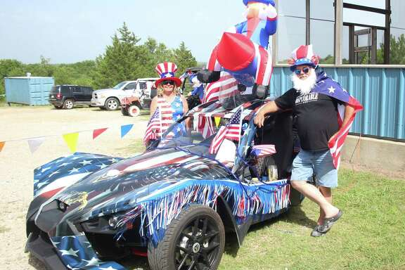 Laquitta Franklin (left) and Brian Franklin (right) show off their Slingshot, which is decorated for American Legion Post 629's contest on June 30.