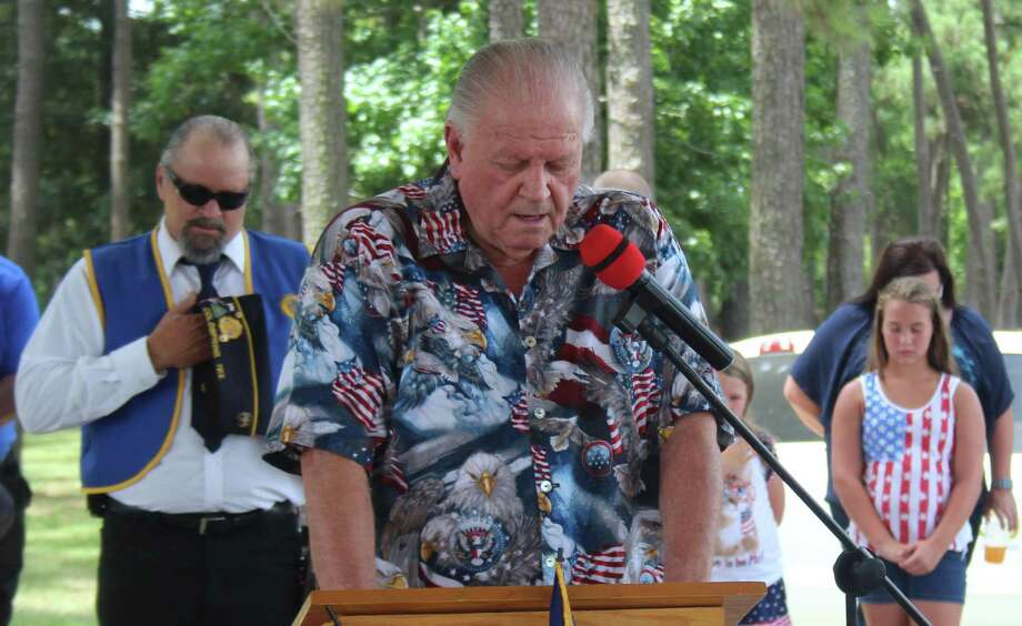 Dale Everitt leads a prayer to begin the Fourth of July Celebration held on June 30 at the Shepherd Community Center pavilion. Photo: Jacob McAdams / HCN