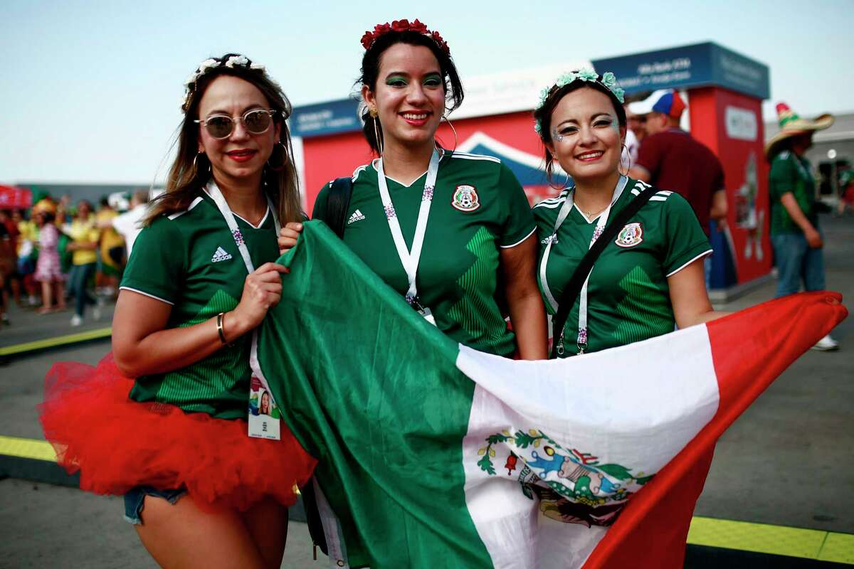 Mexico fans pose before the Russia 2018 World Cup round of 16 football match between Brazil and Mexico at the Samara Arena in Samara on July 2, 2018. / AFP PHOTO / Benjamin CREMEL / RESTRICTED TO EDITORIAL USE - NO MOBILE PUSH ALERTS/DOWNLOADSBENJAMIN CREMEL/AFP/Getty Images