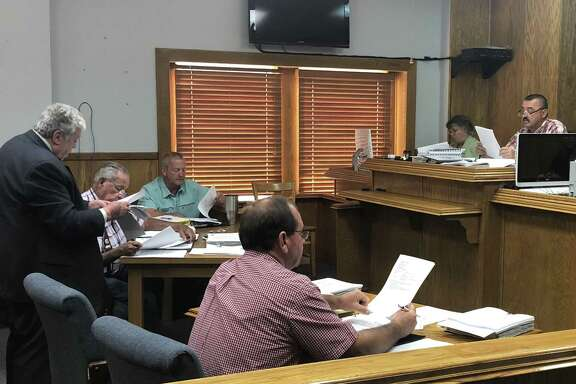 Randy Blanks (left) of Waxman and Associates discusses action items regarding the senior centers in Shepherd and Coldspring during the June 27 San Jacinto County Commissioners Court meeting.