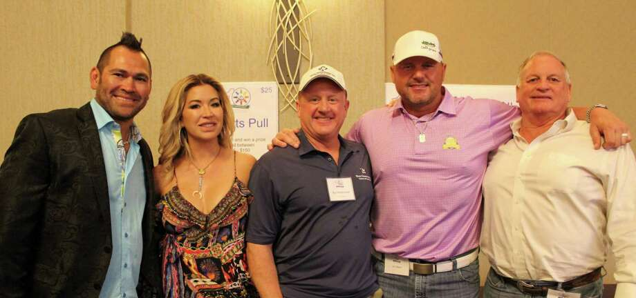 Waste Connections hit their goal to raise $1 million at their recent 10th annual fundraiser, Golf Classic for Kids. Pictured from left: Former Major League Baseball Star Johnny Damon, Michelle Damon, Waste Connections Chief Executive Officer Ron Mittelstaedt, Former Major League Baseball Star Roger Clemens and friend of Roger Clemens, Jim West. Photo: Waste Connections