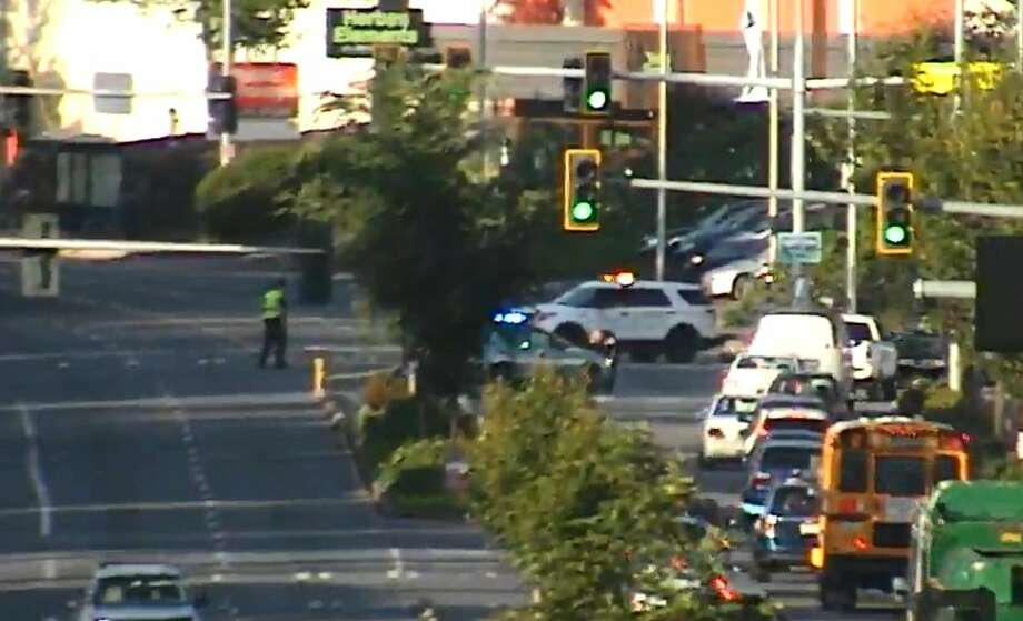 A report of gunfire and a subsequent negotiation have shut down Lake City Way in both directions Monday morning from Northeast 110th and Northeast 113th streets. Photo: SDOT