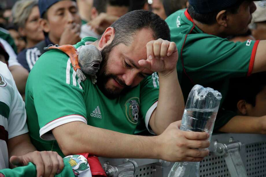 A Mexico soccer fans reacts to Brazil's goal during a live broadcast of the Russia World Cup game in Mexico City's Zocalo plaza, Monday, July 2, 2018. (AP Photo/Anthony Vazquez) Photo: Anthony Vazquez, Associated Press / Copyright 2018 The Associated Press. All rights reserved.