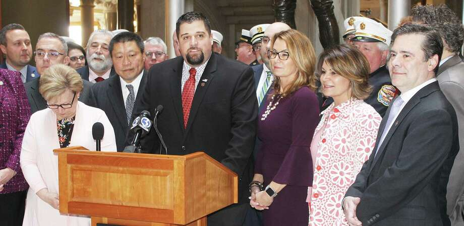 Rep. Brian Ohler, R-Falls Village, center, will receive the Connecticut Firefighters Association's Legislator of the Year award at its convention in September. He is pictured at a press conference to kick off Fire Service Day held earlier this year at the State Capitol. Photo: Contributed Photo
