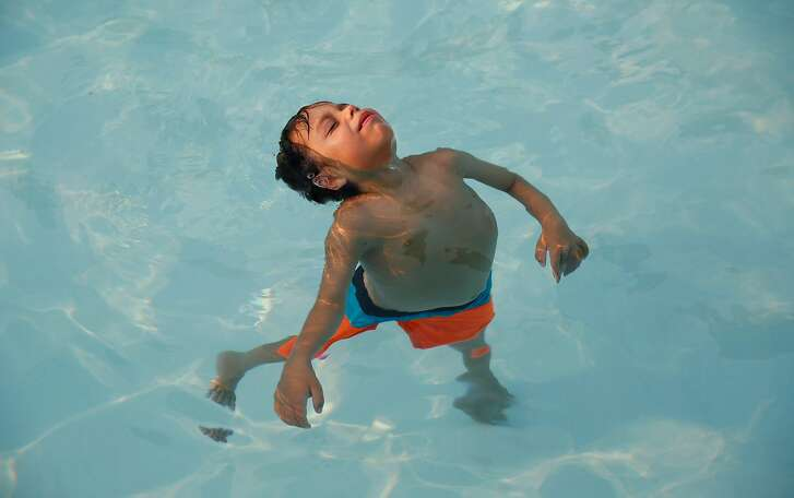 Jordan swims during an adaptive swim class on September 1, 2017.
