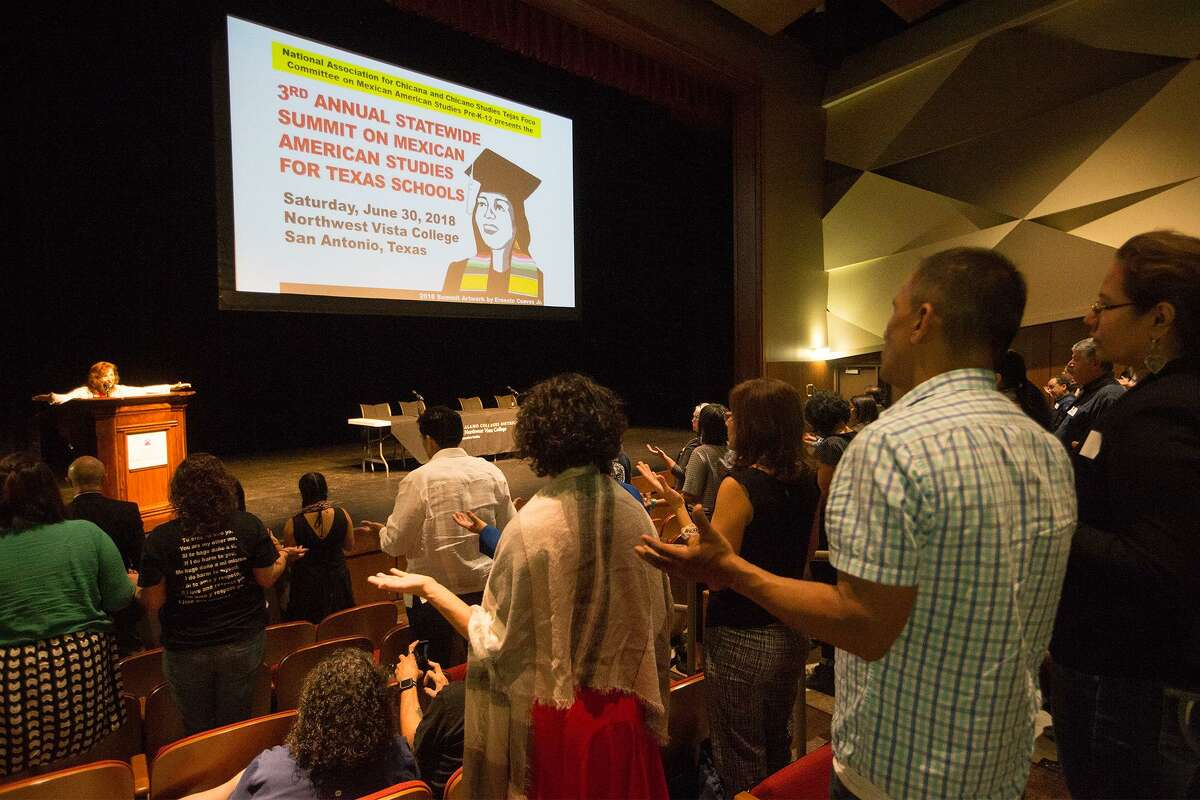 FILE - Dr. Carmen Tafolla (left), president of the Texas Institute of Letter, gives the invocation at the 3rd Annual Statewide Summit on Mexican American Studies for Texas Schools 2018 at Northwest Vista College on Saturday, June 30, 2018. Teachers from all over the state met to identify institutional barriers, establish priorities and develop a plan of action for the implementation of MAS in Texas schools, Pre-K through 12th grade, and for increasing the access to MAS courses and content within the community.