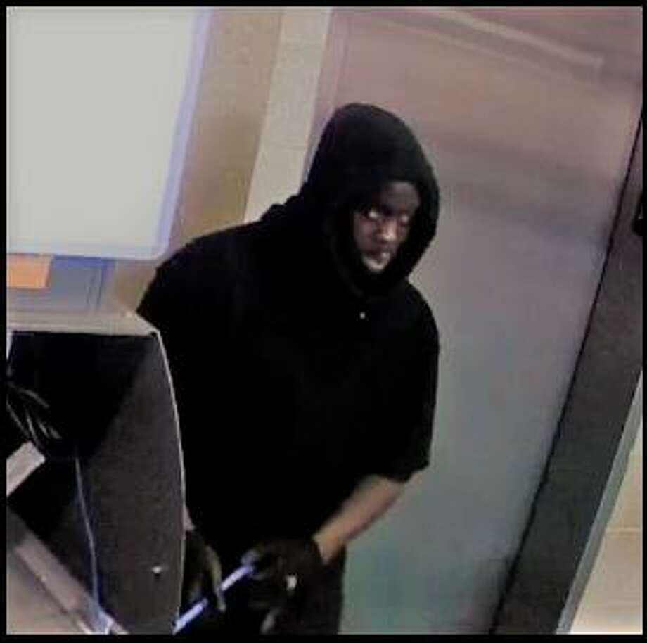 Police need the public's help identifying a man connected to an ATM break-in. Photo: Contributed Photo
