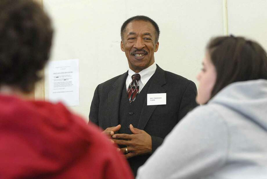Times Union staff photo by Paul Buckowski ---    , (cq) ,  Reverend Cornelius Clark, from Holy Serenity Church of God, talks with Troy High School students on Thursday, Feb. 1, 2007 at Troy High School, during the schools Black History Day.  The school brought in community leaders to talk to students about career options, community relations, citizens' rights and communications. Photo: Paul Buckowski, Hearst / Albany Times Union