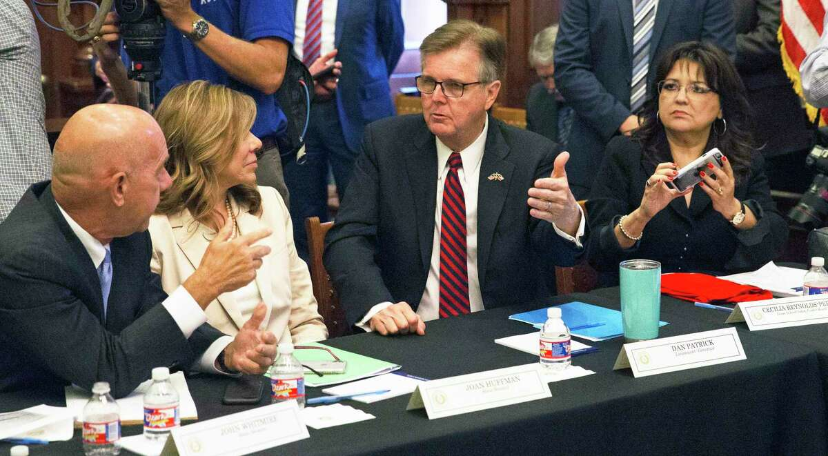 Lt. Governor Dan Patrick talks with Texas Senators John Whitmire and Joan Huffman as Governor Greg Abbott leads a roundtable discussion in his offices on guns in the wake of the Santa Fe shootings on May 22, 2018.
