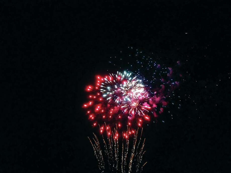 A multi-colored shell bursts over the American Legion Saturday night during the annual Edwardsville fireworks display. In addition to the fireworks, the Legion welcomed guests for live music, entertainment and a performance by the Edwardsville Municipal Band.