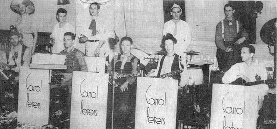 "This popular Carroll Peters Orchestra played for many social events in Alton, including the dances of the DeMolay and Rainbow Masonic organizations, and for college and high school dances. The band broke up after the younger members were drafted at the start of World War II. On the saxophones, from left, Ed Hayes, Art Laux, Les Hoeber and Merle Mussel; on guitar, Joe Crivello; trumpets, Red Harlow, George Loveless and Barney Viviano. Playing the drums was Al Favre and the boss, Tom Head. It was popular for its ""big band"" sound. Photo:       File Photo"
