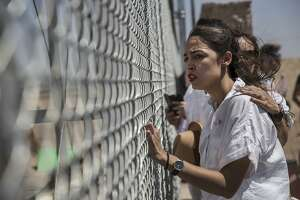 Alexandria Ocasio-Cortez and other demonstrators protest the immigration detention of children in Tornillo, Texas, June 23, 2018. Ocasio-Cortez, who won the Democratic primary in New York's 14th Congressional District on June 27, made abolishing Immigration and Customs Enforcement a central feature of her campaign. (Victor J. Blue/The New York Times)