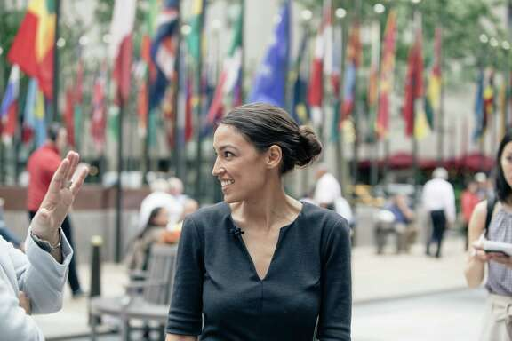 Alexandria Ocasio-Cortez, a political newcomer, talks to reporters in New York, June 27, 2018. Ocasio-Cortez unseated Rep. Joseph Crowley, a 20-year incumbent, in a blow to the Democratic party's traditional leaders. (Annie Tritt/The New York Times)