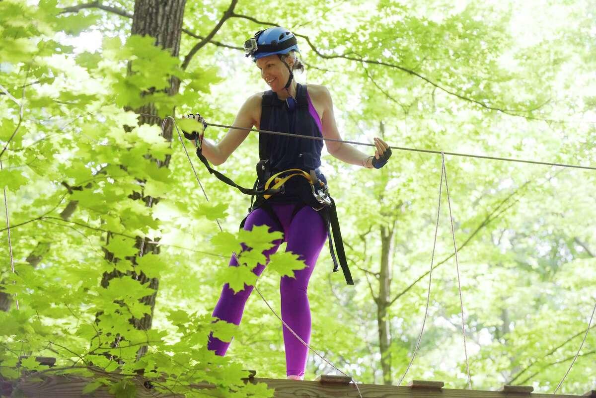 The Times Union's Kristi Barlette makes her way through the Mountain Ridge Adventure ropes course on Monday, June 18, 2018, in Schenectady, N.Y. (Paul Buckowski/Times Union)