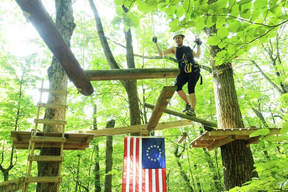 The Times Union's Sara Tracey makes her way through the Mountain Ridge Adventure ropes course on Monday, June 18, 2018, in Schenectady, N.Y. (Paul Buckowski/Times Union)