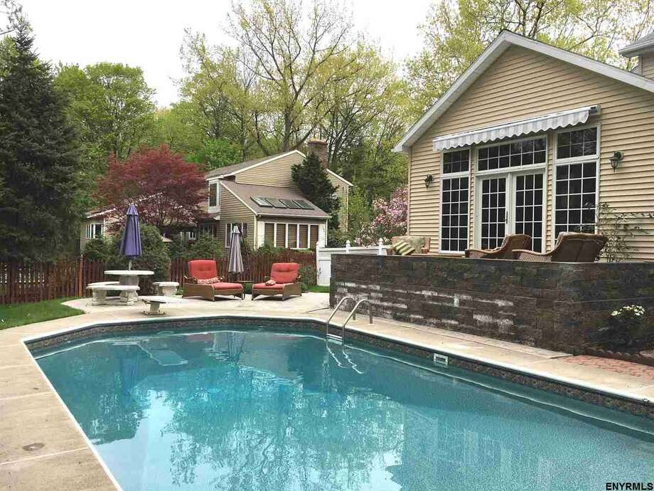 Hot enough for you? Click through the slideshow to view photos of a few area homes for sale with pools. Photo: MLS