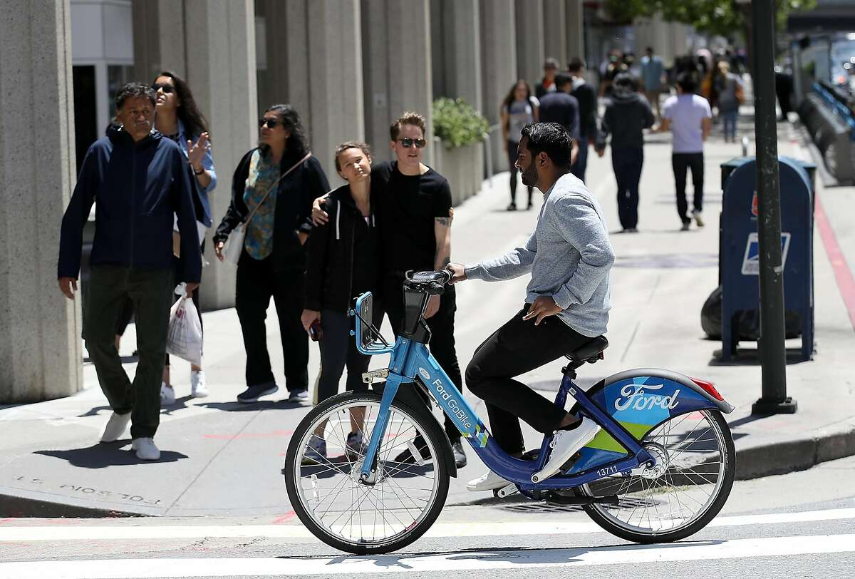 SAN FRANCISCO, CA - JUNE 08: A man rides a Ford GoBike on June 8, 2018 in San Francisco, California. Rideshare companies Uber and Lyft are both reportedly bidding to buy bike share company Motivate that operates CitiBike in New York and Ford GoBike in San Francisco as well as six other cities in the United States. (Photo by Justin Sullivan/Getty Images)