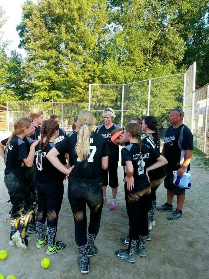 Bullock Creek players huddle during the major softball district tournament hosted by Bullock Creek last week. (Photo provided by Christina Richardson)