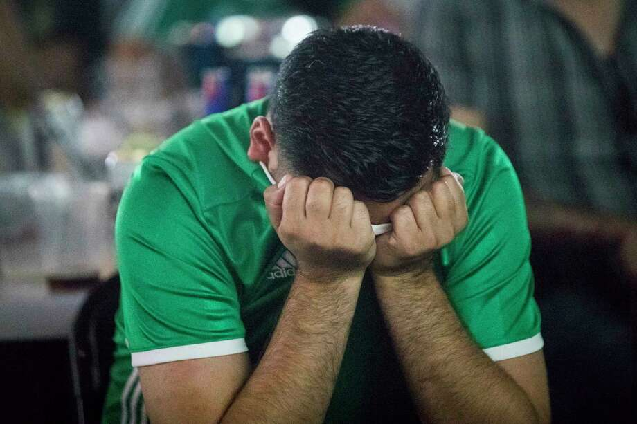 A Mexico soccer team fan covers his face as the Mexico team loses a match against Brazil, Monday, July 2, 2018. Photo: Marie D. De Jesús, Houston Chronicle / © 2018 Houston Chronicle