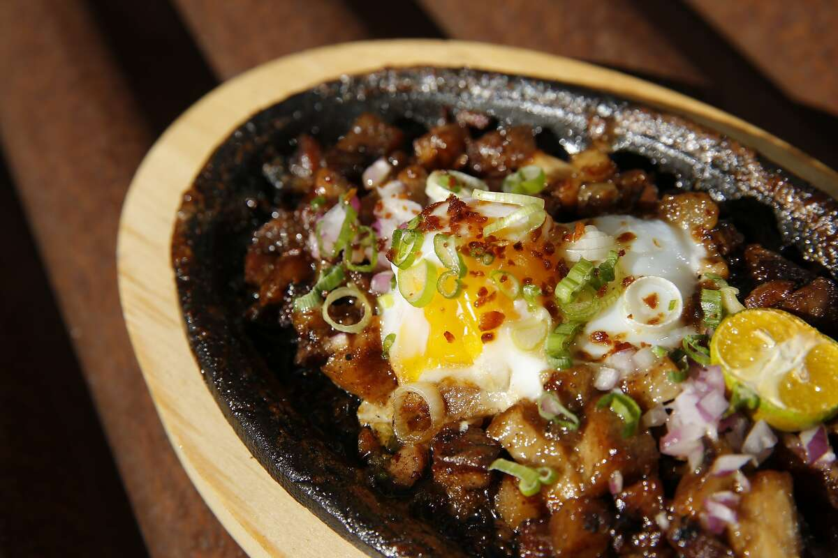 Likha's pork sisig at the Hometown Heroes sports bar, Saturday, June 30, 2018, in Emeryville, Calif. The Filipino-American food pop-up Likha is inside the Hometown Heroes sports bar located at 4000 Adeline Street.