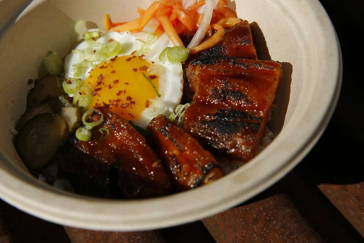 Likha's tocino silog at the Hometown Heroes sports bar, Saturday, June 30, 2018, in Emeryville, Calif. The Filipino-American food pop-up Likha is inside the Hometown Heroes sports bar located at 4000 Adeline Street.