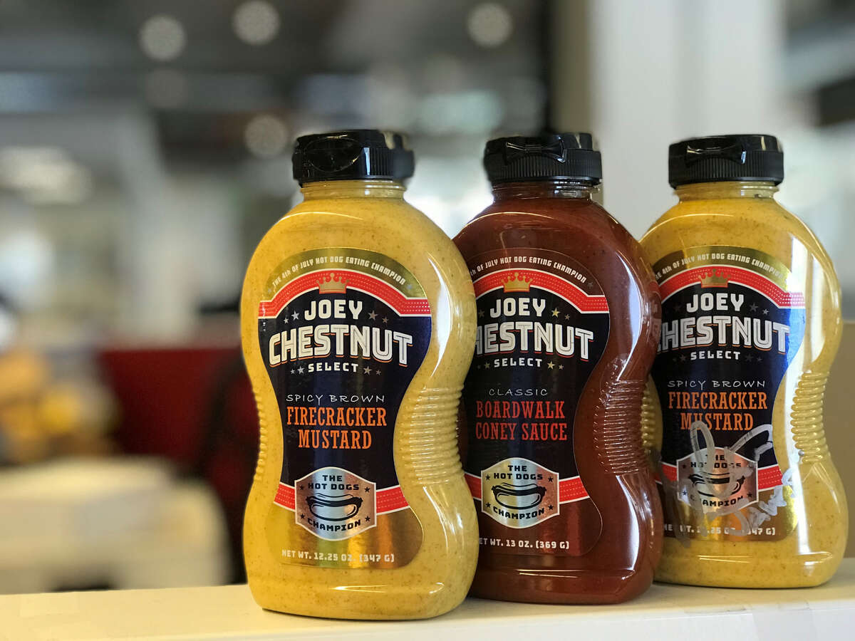 Competitive eater Joey Chestnut has launched a new line of condiments with online sales benefiting military caregivers this week.