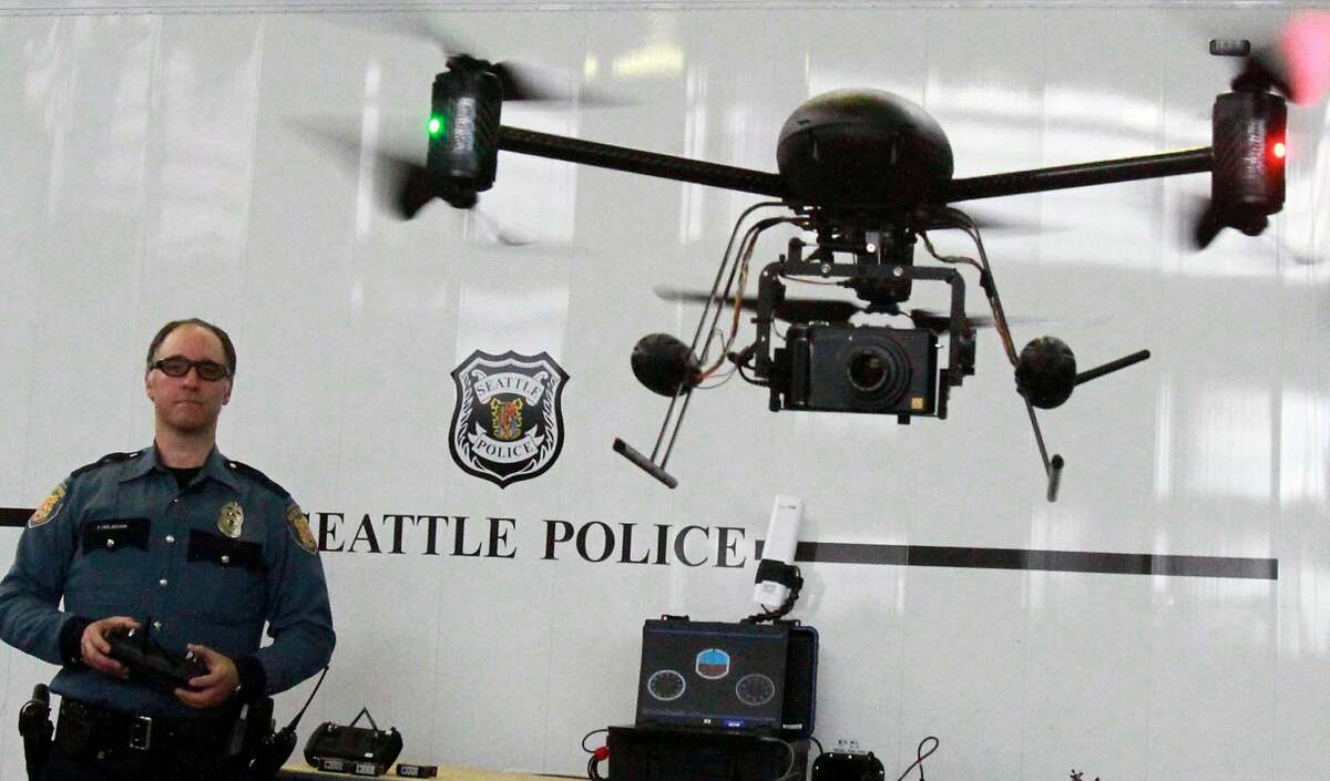 In this April 27, 2012, photo, Seattle Police officer Reuben Omelanchuk is at the controls of the department's new, small radio-controlled Draganflyer X6 drone with a camera attached, in Seattle. The mayor of Seattle is ending the police department's drone program after local residents protested, Thursday, Feb. 7, 2013. (AP Photo/The Seattle Times, Alan Berner) MAGS OUT; NO SALES; SEATTLEPI.COM OUT; MANDATORY CREDIT