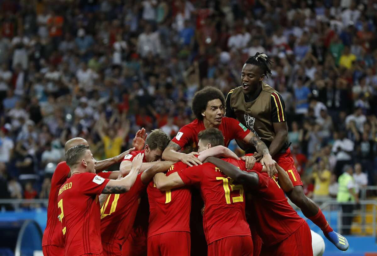 Belgium's players celebrate Nacer Chadli's third side's goal during the round of 16 match between Belgium and Japan at the 2018 soccer World Cup in the Rostov Arena, in Rostov-on-Don, Russia, Monday, July 2, 2018. (AP Photo/Rebecca Blackwell)