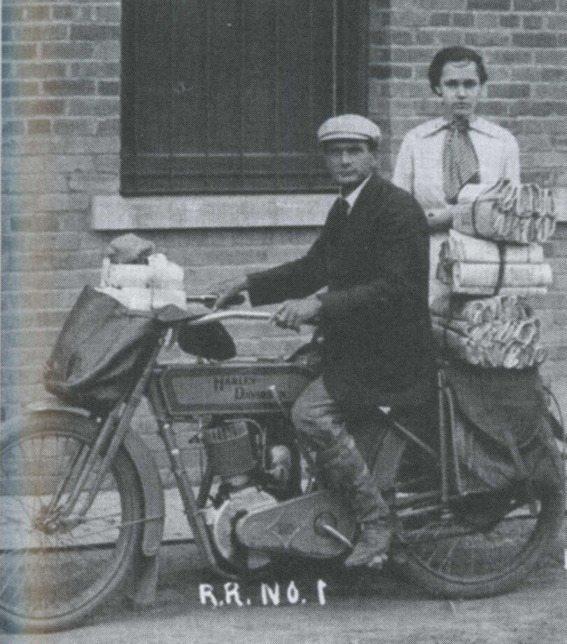 During the early 1900s, A.J. Chambers was Rural Route 1 mail carrier for the Plainview Post Office. He usually used a side car with his Harley Davidson motorcycle to carry the extra mail. When it was cold or muddy, Chambers used a horse and buggy to deliver mail along his rural route. He is shown with his daughter, Abbie Chambers, in the photo from about 1911 which was provided by members of his family. Chambers was on vacation from the post office with his wife and an all-girls church quartet when their auto caught in a flash flood outside Carlsbad, New Mexico. Chambers and two of the girls, including his 17-year-old daughter Eunice, drowned. Chamber's wife and the other two girls were pulled from the raging torrent and survived. Photo: Herald File Photo