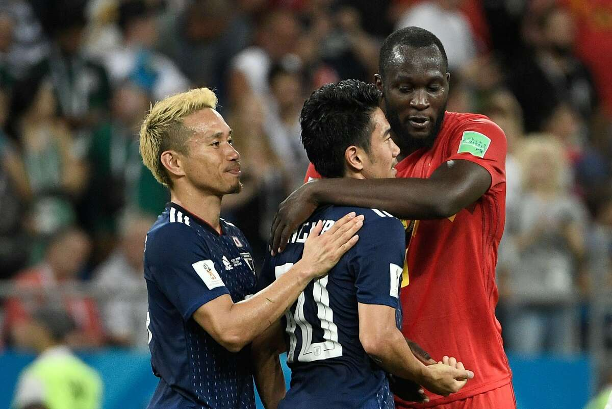 Belgium's forward Romelu Lukaku (R) speaks with Japan's midfielder Shinji Kagawa (C) after the Russia 2018 World Cup round of 16 football match between Belgium and Japan at the Rostov Arena in Rostov-On-Don on July 2, 2018. Belgium scored a last-gasp winner to beat Japan on Monday and set up a World Cup quarter-final against Brazil. / AFP PHOTO / Filippo MONTEFORTE / RESTRICTED TO EDITORIAL USE - NO MOBILE PUSH ALERTS/DOWNLOADSFILIPPO MONTEFORTE/AFP/Getty Images