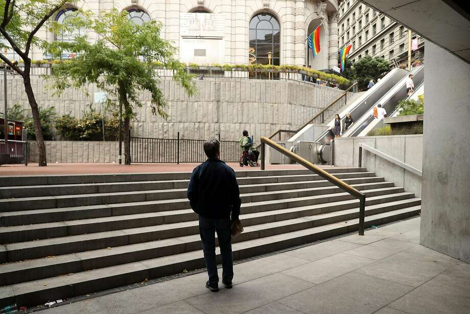 A file photo of Hallidie Plaza near the Powell Street BART station. A man was found with life-threatening stab wounds Wednesday night in Hallidie Plaza, and San Francisco police said his attackers are still at large. Photo: Scott Strazzante, The Chronicle