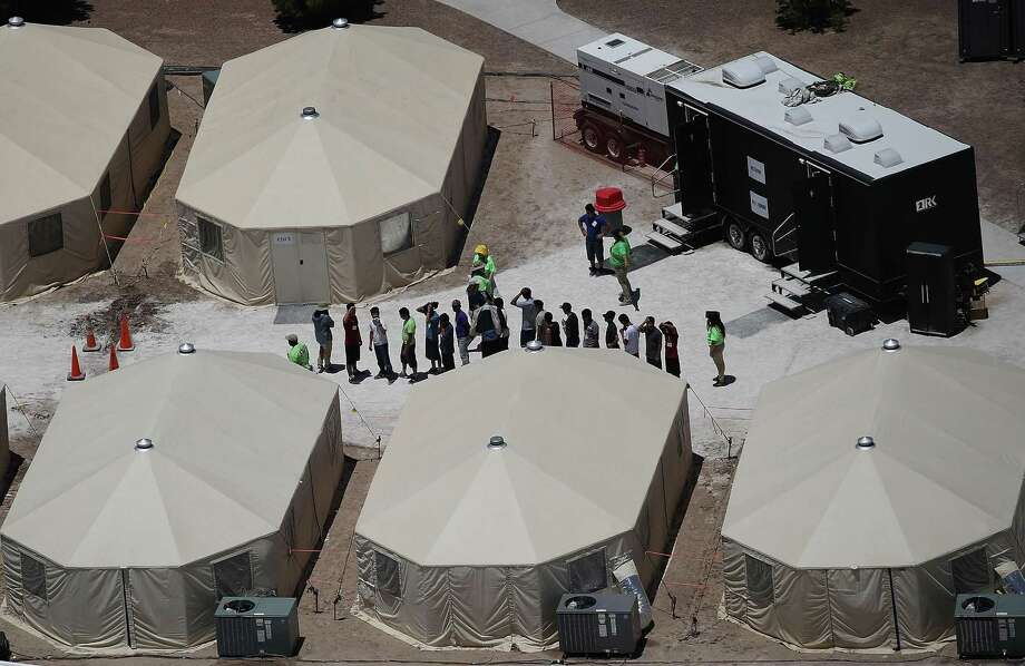 PHOTOS: 2018 immigration crisisChildren and workers are seen at a tent encampment recently built near the Tornillo Port of Entry on June 19, 2018 in Tornillo, Texas. The Trump administration is using the Tornillo tent facility to house immigrant children separated from their parents after they were caught entering the U.S. under the administration's zero tolerance policy. >>Photographers document the immigration crisis along the border...  Photo: Joe Raedle, Staff / Getty Images / 2018 Getty Images