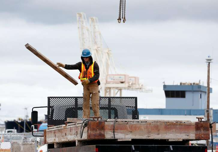 A construction crew works on a new ferry terminal near the old Ford assembly plant and Craneway Pavilion in Richmond, Calif. on Tuesday, May 15, 2018. The terminal is expected to boost the number of commuters and visitors to the area when ferry service begins in the fall.