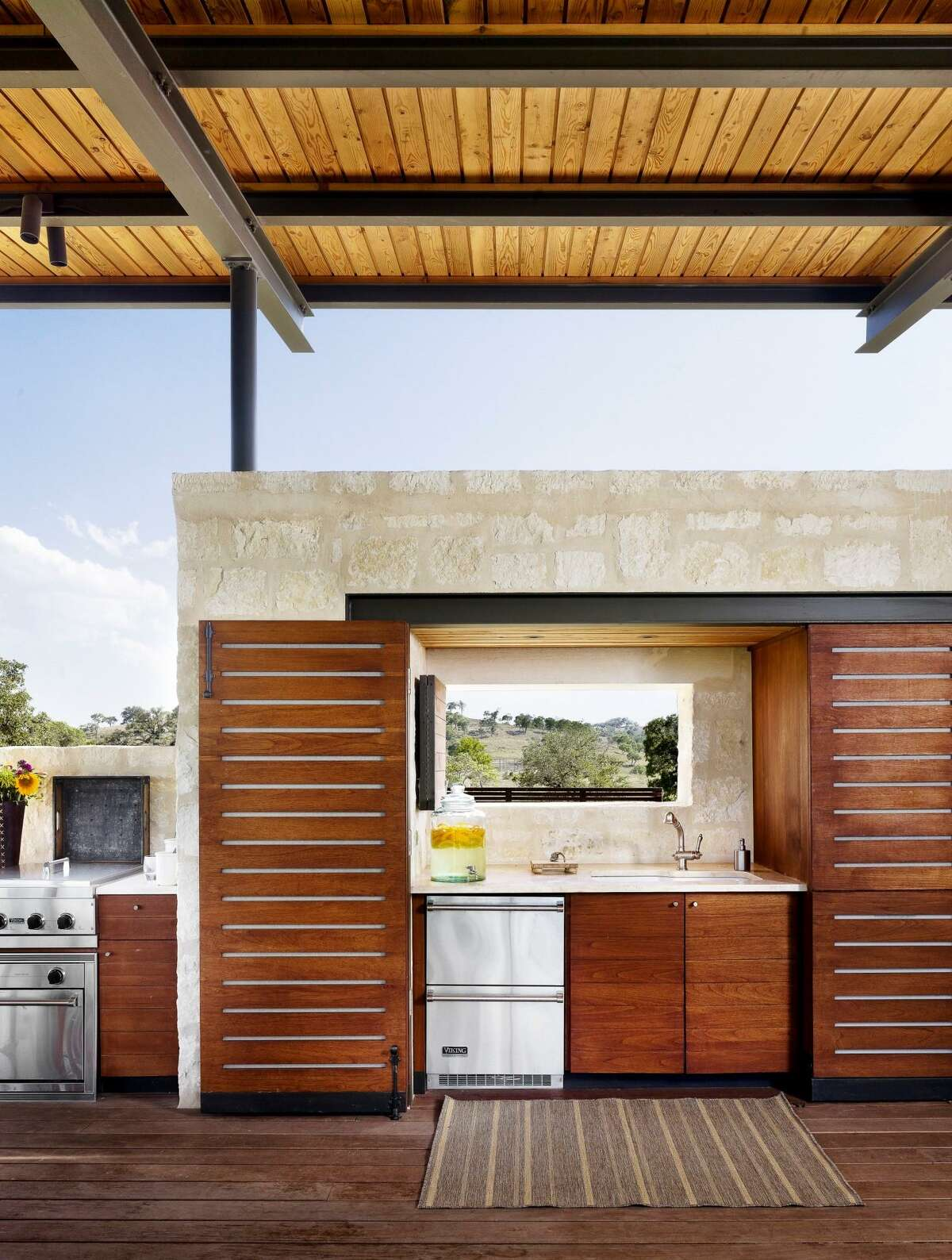 Another look at the pool pavilion shows how doors open to reveal the sink area for easy clean up.