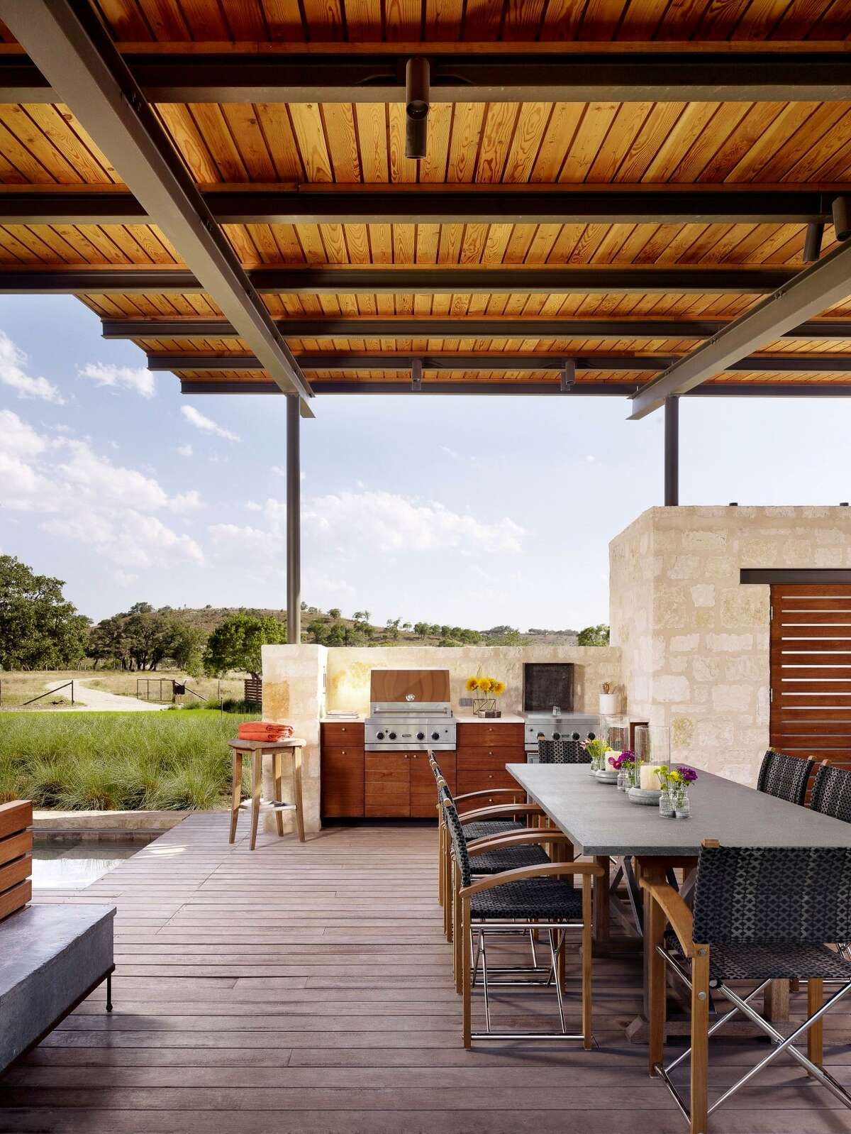This outdoor pavilion is made of materials that will withstand the weather, including a durable, tropical hardwood called Ipe used in the decking. The standard chlorine pool, is finished with limestone to give it a warm look that plays off the limestone usedfor the half walls.