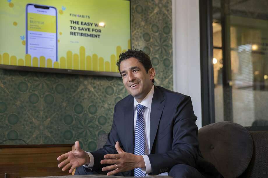 In this Tuesday, May 22, 2018 photo, Carlos Garcia, founder and CEO of Finhabits, speaks during an interview with The Associated Press in New York. Finhabits is a bilingual digital platform designed to make savings and investment accessible for Hispanics. (AP Photo/Mary Altaffer) Photo: Mary Altaffer, Associated Press