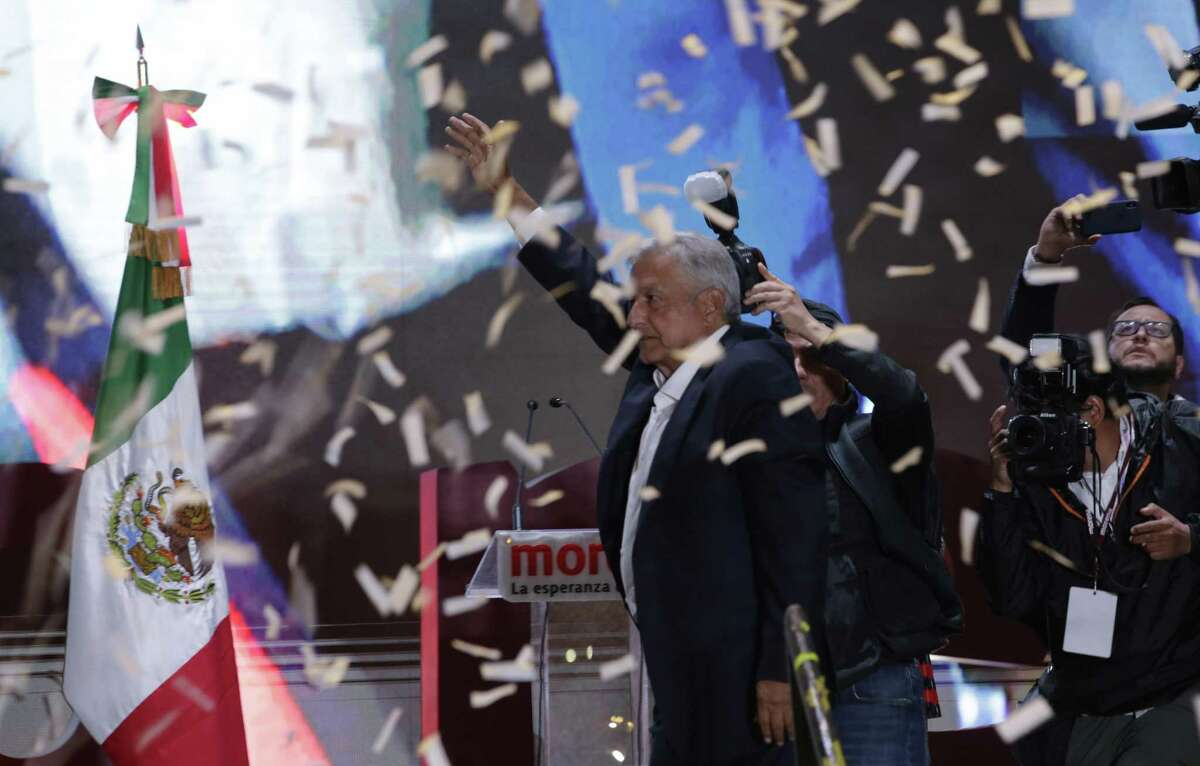 Presidential candidate Andres Manuel Lopez Obrador waves to supporters as he arrives to celebrate his victory in Mexico City's main square, the Zocalo, late Sunday, July 1, 2018. Mexican voters elected Lopez Obrador as their new president, after an election driven by widespread frustration and anger of the country's corruption and violence.