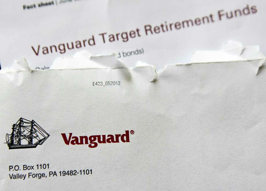 Vanguard, the world's second-largest money manager, collected $138 billion in the first half of 2018, down from $237 billion in the same period a year ago, according to the firm. That's a decline of 42 percent. By comparison, total U.S. fund flows — money going into exchange-traded, active and passive mutual funds — fell roughly 50 percent, according to Bloomberg estimates. Photo: Keith Srakocic /Associated Press / Copyright 2018 The Associated Press. All rights reserved.